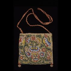 """Canvaswork Purse or """"Sweet"""" Bag 1600-1640 Origin: England 5 X 5 1/4"""" with 13"""" handle extensions. Silk and metallic embroidery threads on linen (or bast) canvas ground; fragmentary silk and linen lining Gift of Mrs. Cora Ginsburg. Acc. No. 1991-489"""