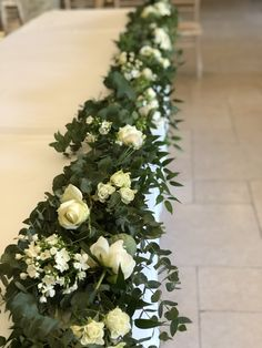 Gorgeous white and green top table floral garland. Wedding Top Table Flowers, Green And White Wedding Flowers, Wedding Table Garland, White Roses, White Flowers, Wedding Decorations, Green Garland, Rose Garland, Floral Garland