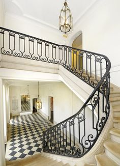 Unbelievable French style sweeping staircase and grand foyer in a dilapidated yet still grand estate in Lake Bluff, Illinois by David Adler. Badly in need of restoration, but what a beauty.
