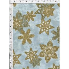 Golden snowflakes drift across a background of light, hazy blue and overlap with gossamer white snowflakes. www.americasbestthreads.com