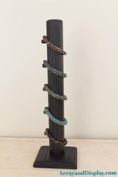 Tall vertical wood bracelet display for stacking multiple bracelets. For home and commercial use. Handcrafted. Made in the USA