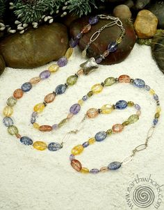 https://earthwhorls.com/products/1480sn  The song of stones - one of a kind, handmade, natural stone, gemstone , chakra stone, sterling silver necklace by EarthWhorls.  Free shipping/online shopping and free holiday gift wrap!