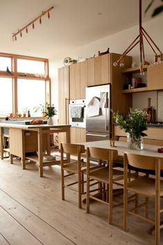 """John Baker & Juli Daoust/Studio Junction kitchen, via Remodelista. The dining chairs are Borge Mogensen Shaker Chairs """"The joinery and many of the proportions of the cabinetry were derived from furniture pieces by Mogensen."""""""