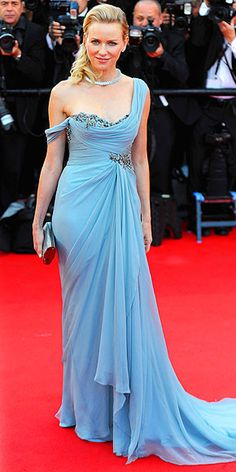 NAOMI WATTS She may be in the France, but Naomi's look is reading very Greek goddess to us. She selects a draped Marchesa confection with a train and an asymmetrical off-one-shoulder neckline adorned with crystals, adding a swept-back hairstyle and a Bulgari serpent necklace for the How to Train Your Dragon 2 red carpet.