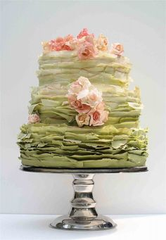Maggie Austin ombre ruffle cake. this, in all pinks. green-tinged blush flowers. green and gold tinges on some of the fondant ruffles. Somehow she makes the ruffles resemble lichens! Amazing.