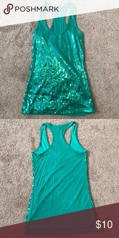 Green Sequin Tank Top Green Razor Back Sequin Tank Top. Sequins are only on the front. Never been worn. Smoke Free Home. Tops Tank Tops