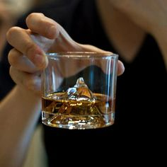 Take scotch on the rocks to new heights with the spectacular crystal Matterhorn Glass. At 4,478 metres (14,690 ft), the Matterhorn drives a familiar wedge between Switzerland and Italy. Parting the dazzling Alpine air with its rugged facets and picture-postcard looks, the summit has been enticing brave adventurers for centuries. Glass crystal whisky tumbler. Base of the glass features a replica of the Matterhorn. Measures approximately 72cm x 72cm x 63cm. Please allow 2 weeks for shipping.
