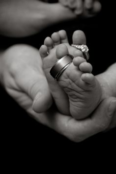 Newborn photo baby toes and feet with wedding rings