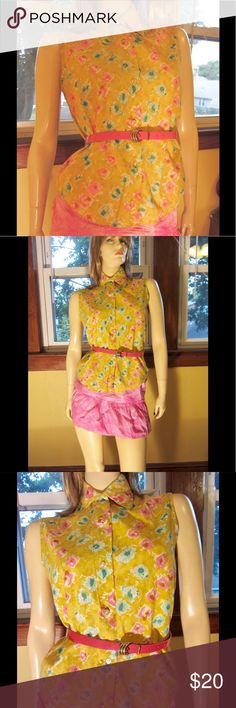 """Vintage Swanky 60s Floral Watercolor Summery Top Super Swanky vintage 60s soft cotton top in golden yellow in a pastel watercolor floral print. Sleeveless buttondown style w/collared neckline. Figure flattering & super stylish.  Size: 16/36 (Fits like a M)  Bust: 38"""" Waist: 38"""" across bottom Length: 21"""" sh-hem, 12 1/2"""" underarm to hem.  Label: Made In USA (embroidered label) Material: 100% Cotton Color: Gold floral print Vintage Condition: EX/One flaw: a small tear (approx. 1"""") under rt. arm…"""
