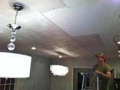Styrofoam ceiling tiles glue right on top of popcorn ceilings...so cool!!!