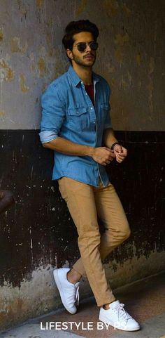 Handsome male model wearing a blue denim shirt and brown chinos styles urbains, blue shirt Fashion Blogger Style, Mens Fashion Blog, Trendy Fashion, Man Fashion, Men Fashion Casual, Fashion Ideas, Brown Fashion, White Fashion, Fashion Shoes