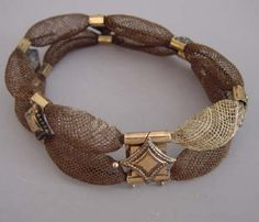 Victorian Hair Bracelet: ca. 1870, two open weave hair portions with gold stations.
