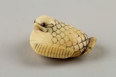 Netsuke of a Plum Sparrow Date: late 18th century Culture: Japan Medium: Ivory, horn Dimensions: H. 7/8 in. (2.2 cm); W. 1 3/4 in. (4.4 cm)