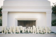 Candle in fireplace wedding ceremony backdrop | Lauren Carroll Photography