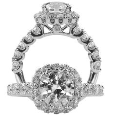Masterwork diamond engagement ring featuring a cushion halo with a prong set round cut centerstone that is surrounded by shared prong round cut diamonds with five shared prong round cut diamonds on either side of the centerstone.