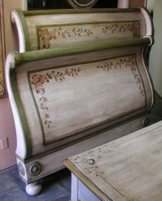 Hand painted sleigh bed in rose design over antique white base. Part of Olinda Romani's French painted collection.