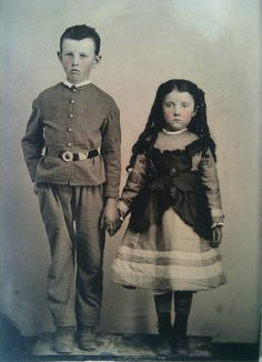 Interesting pinafore on little girl.  brother and sister holding hands.  Tintype 1870s