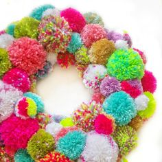This year go bright and make this amazing pompom wreath designed by @sfmgs. This will look amazing on your front door this Christmas.