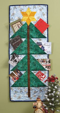 This wallhanging quilt pattern, Season's Greetings by Diane Tomlinson using…