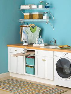 Our laundry room is in the unfinished basement- making a room out of it with all these compartments built in would be awesome! A counter to fold on, a sink for handwashing- with a set up like this I won't complain about laundry again :)