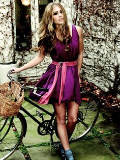 i love the background with the bike ... and the basket .... totally works perfectly with her dress =]