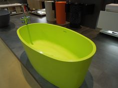 Yes, this tub from Blu Bathworks is a yummy lime green. Not trendy but smart, white which isn't fired can get dingy over time, this won't. And they even have it in Lisa Blue! Black Water, Bathroom Fixtures, Faucet, Bathroom Ideas, Lisa, Bathtub, Community, Exterior, Canning