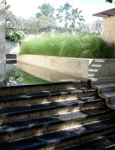 Nice detail integrating the steps into a water feature. Pinned to Garden Design - Water Features by BASK Landscape Design.