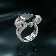 Absolutely exquisite! ! Black Diamond set in white Diamond engagement ring