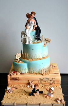 Like the beachy details on this cake - could be adapted for a very cute birthday cake.