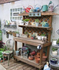 diy potting bench out of scrappy fencing & tables... plants potted in random repurposed things