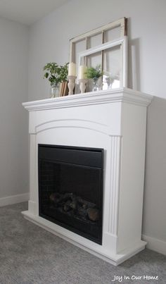 Farmhouse Fireplace Makeover Farmhouse Fireplace Makeover Danielle geoffroy daniellegeoffr foyer An electric fireplace gets a new lease on life This stunning FAT Paint nbsp hellip Candles In Fireplace, Fake Fireplace, Fireplace Cover, Farmhouse Fireplace, Cozy Fireplace, Living Room With Fireplace, Fireplace Surrounds, Electric Fireplace, Fireplace Ideas