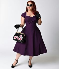 http://www.unique-vintage.com/brands-we-love/stop-staring/stop-staring-plus-size-mad-men-eggplant-pleated-bodice-cap-sleeve-swing-dress.html