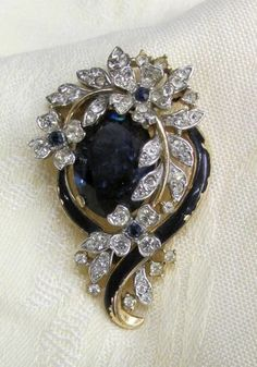 1940s Signed Trifari Rhinestone & Cobalt Blue Enamel Jewelry Wispy Pin Brooch This same set it owned by the Metropolitan Museum of Art