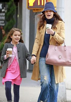 Warming up: Katie Holmes and her daughter Suri Cruise called in for a hot beverage at a Starbucks near their home in Manhattan, New York on a chilly Sunday