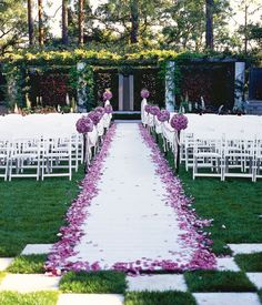 Dress up a simple white aisle runner with a pretty border of lavender rose petals.