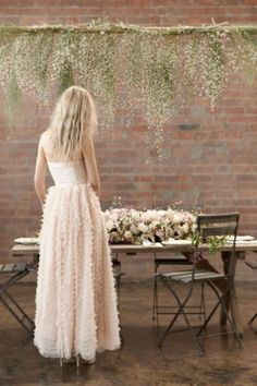 Hanging spanish moss+baby's breath combined with blush chiffon. Use fishing line to hang them lower behind the bridal table. Creates a fuller effect.