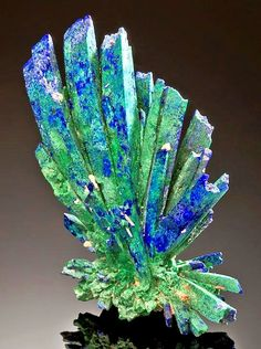Incredible specimen featuring a dramatic spray of Azurite crystals with ps to Malachite!  For a miniature sized specimen, this piece...