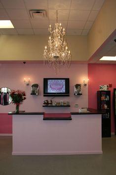 Salon. Front desk, TV behind desk hate the colors,....