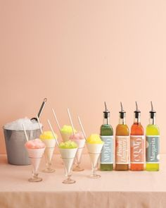 Sweet Snow Cone Station-This classic refreshment is all grown up. During the reception, adults can help themselves at a station stocked with cups, crushed ice, and mojito, peach daiquiri, cosmo, and margarita cocktail syrups. Use glasses to catch drips and straws to slurp up every last drop. Sur La Table olive oil cruets with pourers.