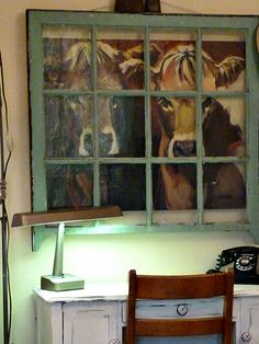 two very cute cows peeking through an old window... And I already own the cows!  And a window!