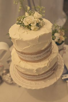 Cake decorated with lace and hessian and champagne as the rising agent. Photo by ben clarke photography