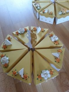 Golden wedding anniversary table centre pieces. Made out of card to build up into a cake, for Anna's golden wedding anniversary.