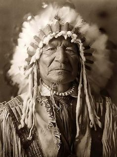Sitting Bear, 1908. Photographer: Edward Curtis. Native American, indian, feather, head piece, a face that have many stories to tell, outfit, culture, male, man, proud, wild, vintage, photo, sapira.