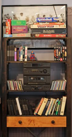 Throwback Books and Games Seinfeld, 90s Things, Hgtv, Bookcase, Condo, Shelves, Bookcases, Book Furniture, Bookcase Closet