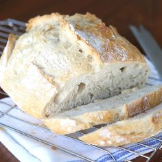 Learn how to make this easy artisan bread. Only 4 ingredients in the recipe and 5 minutes of work for beautiful crusty, soft and tender homemade bread.