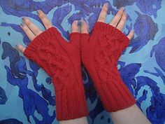 "I designed these gloves, in blazing ""commie red,"" for my little brother, who spent the last year protesting economic injustice while living on the chilly streets of Seattle. At one point he and his friends occupied a foreclosed and abandoned ex-home, which they named ""Turritopsis Nutricula House"" after the immortal jellyfish that can revert to earlier stages of its development after growing old. The jellyfish, like the people's movement, never dies."
