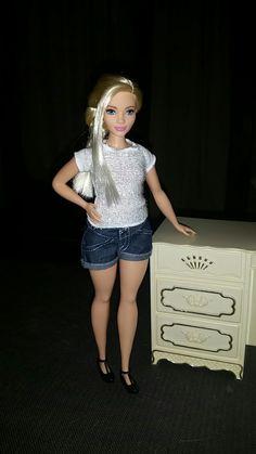 Curvy Barbie wearing Lammily's shorts.