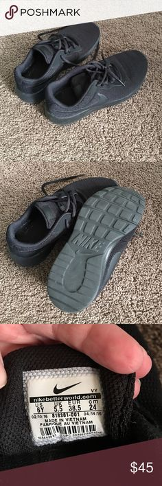Nike Tanjun running shoes Size 6 youth all black Nike Tanjun running shoes. Only worn occasional for 1 month. I got new inserts for my shoes and had to go up a size. These are in great condition. Bought in the youth section. Fits a woman size 5.5/6 Nike Shoes Athletic Shoes