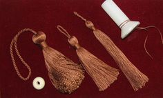 Three tassels made from a spool (90 yds.) of size FFF Gudebrod Bros. Champion silk thread. From left to right the first tassel is type 2 with an 18x10 mm wooden bead inside the body, the middle one is also type 2 with no bead and the last is type 3 also without a bead.