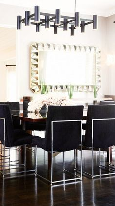 In this dining room, a faceted mirror and delicate crystal sconces are expertly matched with a matte-finish grid light fixture and black velvet dining chairs. The repeated rectangular shapes unify the seemingly opposing elements. Unique Furniture, Shabby Chic Furniture, Kitchen Furniture, Furniture Nyc, Classic Furniture, Beautiful Dining Rooms, Elegant Dining, Fashion Room, Eclectic Decor